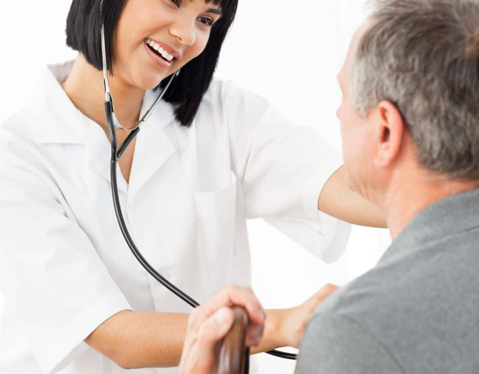 bigstock Senior laughing with his nurse 13755707